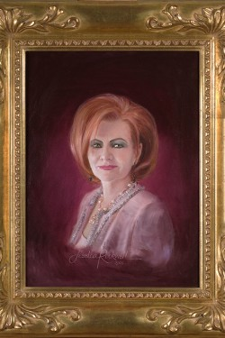 commissioned oil portrait of red haired woman with frame